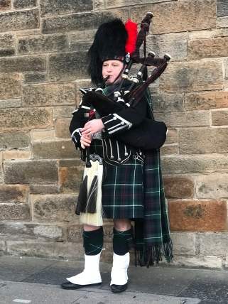 A Scotsman playing the bagpipes!